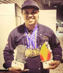 Kenneth Cacho of Batch 1990 proudly shows his trophies and medals during the 2015 Philippine Culinary Cup