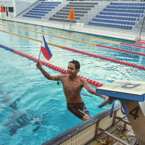 Sacho Ilustre waves the Philippine flag after finishing his event.