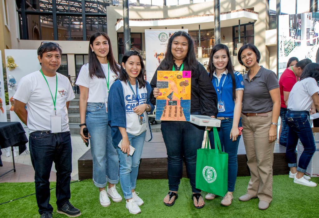 The High School (non-DLSZ) category winner, Victoria Cristina Dimaunahan (third from right), receives her award.