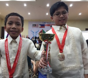 All smiles for Joshua Milan (left) and Aldrich Joshua Kimwell (right) after receiving their trophy during the awarding ceremony.