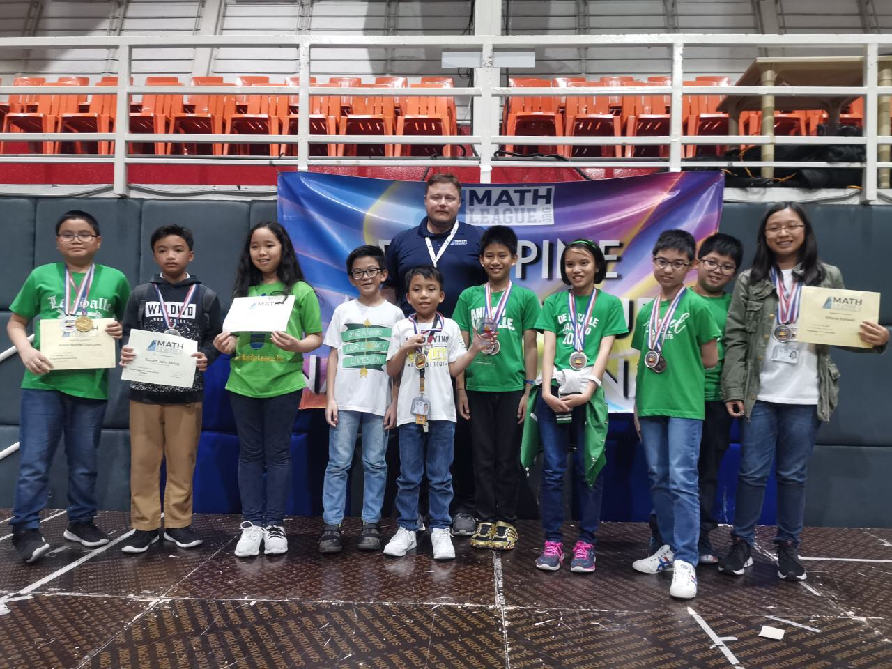 DLSZ Mathletes with Mr. Tim Sanders, the Founder and President of Math League who was the guest of honor during the awarding. (L-R) Anton Gonzales, RJ Sering, Reese Albano, Gian Casimiro, Joshua Milan, Gian Ignacio, Julia Cruz, Jacob Bernas, Aldrich Kimwell, & Athena Kimwell.