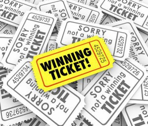 29296731-one-winning-ticket-on-pile-of-losing-entries-in-lottery-or-raffle-for-cash-or-prizes (1)